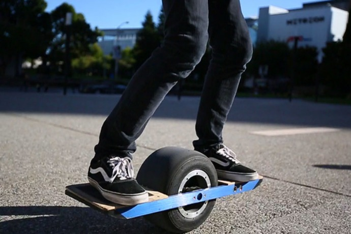 men standing on the onewheel balancing electric skateboard