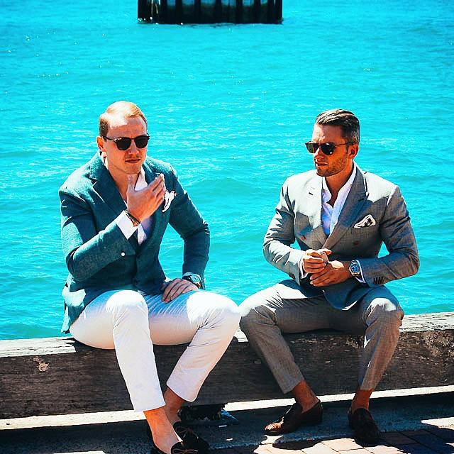 miles wharton stylish sitting beside ocean