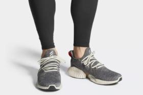 full view wearing adidas sneakers