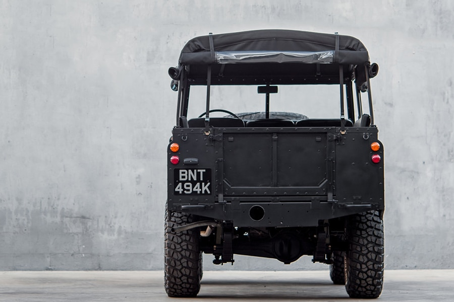blacked-out defender back view