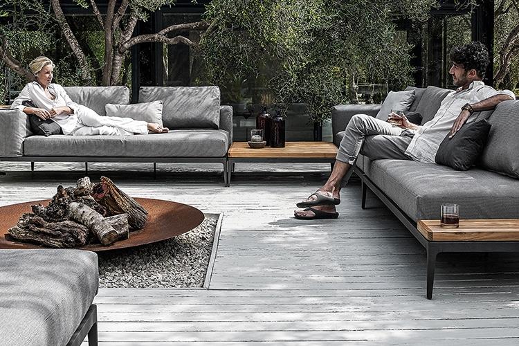 people sitting on grid sofa