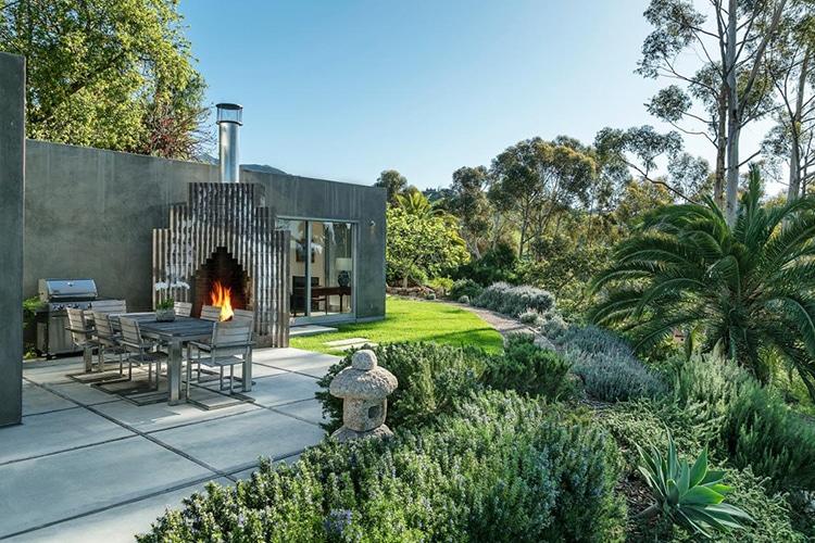 natalie portman house backyard fireplace and natural scene