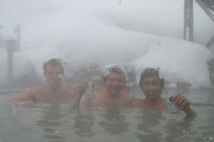 men drink beer in the pond