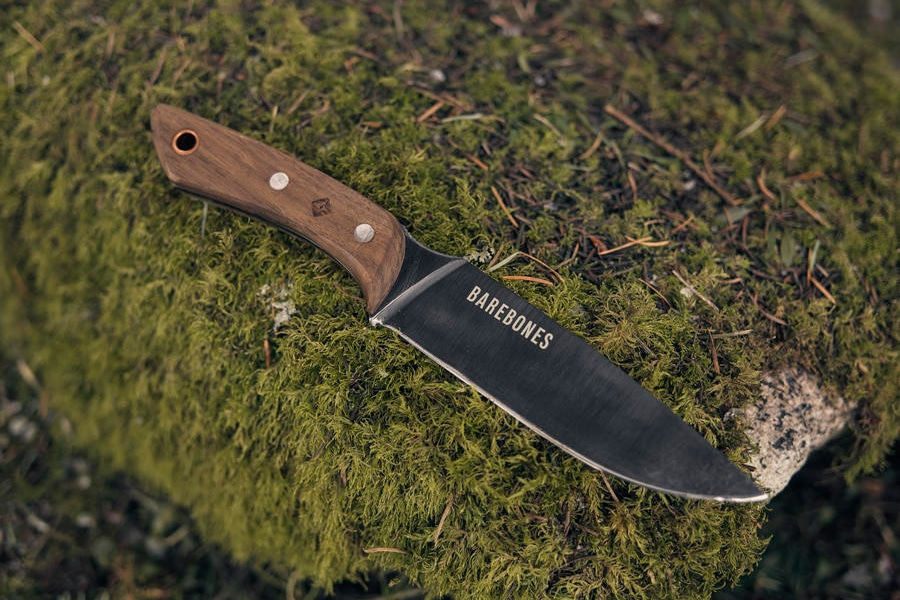 field pocket knife in grassy stone