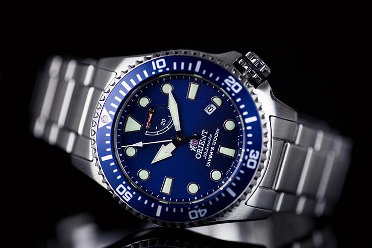 orient triton watch blue and round shape crown
