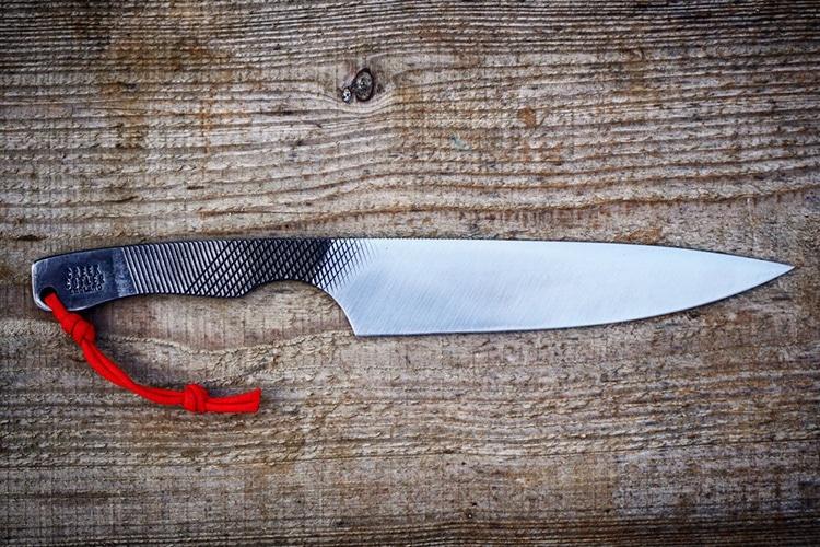 creek cutler knife on the wood