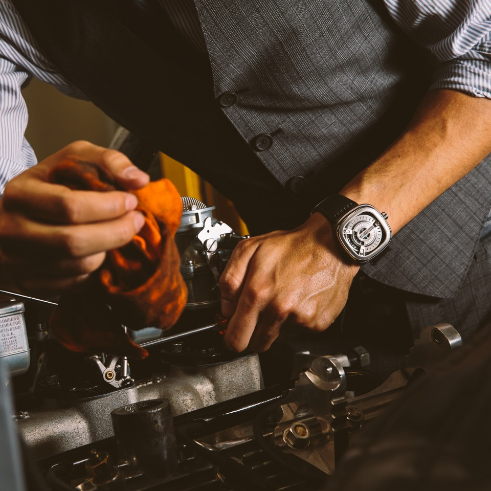 men wearing sevenfriday watch working in the factory