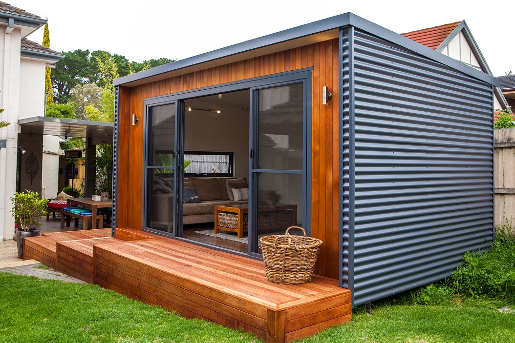 Inoutside outdoor rooms man of many for Prefab garden room