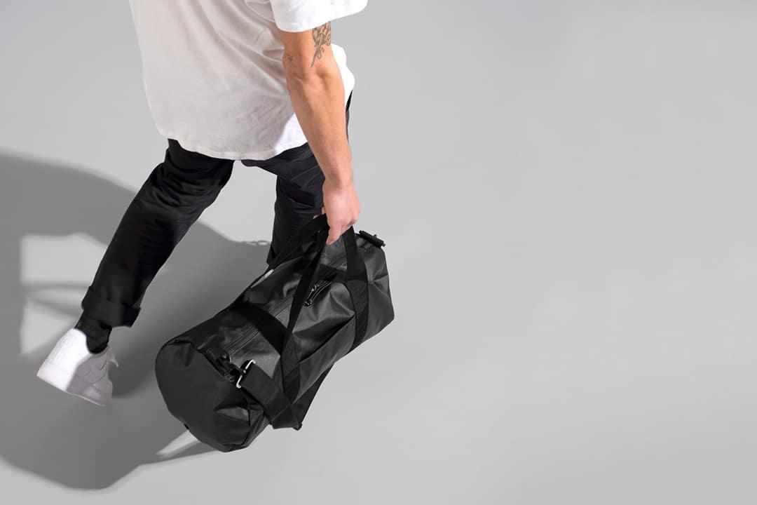 High angle shot of a man with a black duffle bag