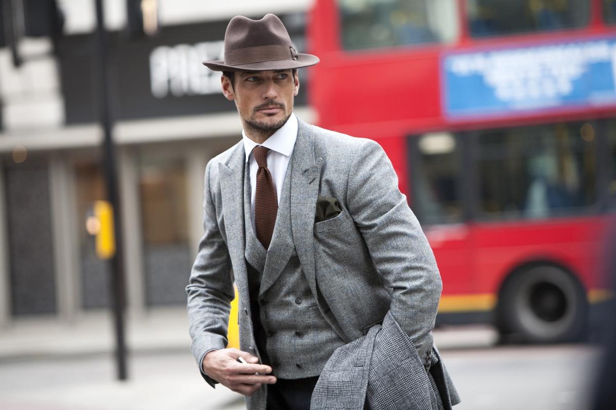 confident men wear suit with cap