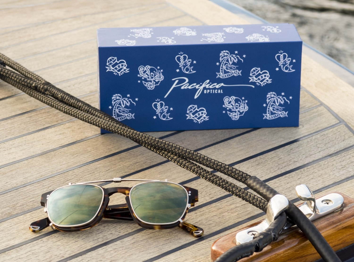 yacht master sunglasses on the wood