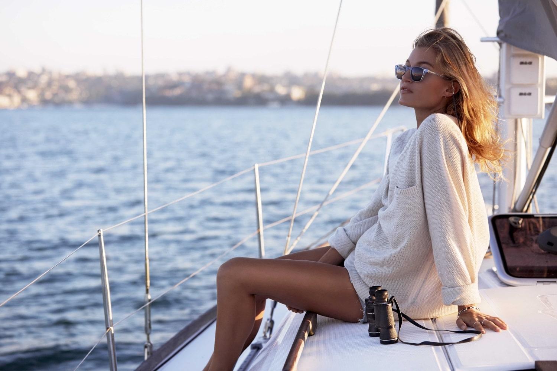women wearing yachtmaster sunglasses in ocean