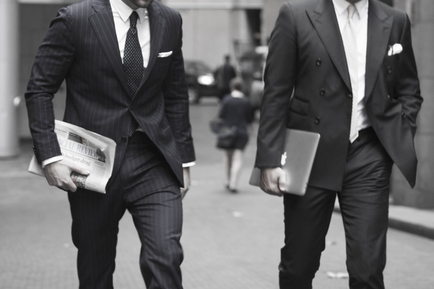 tailored suit persons are walking