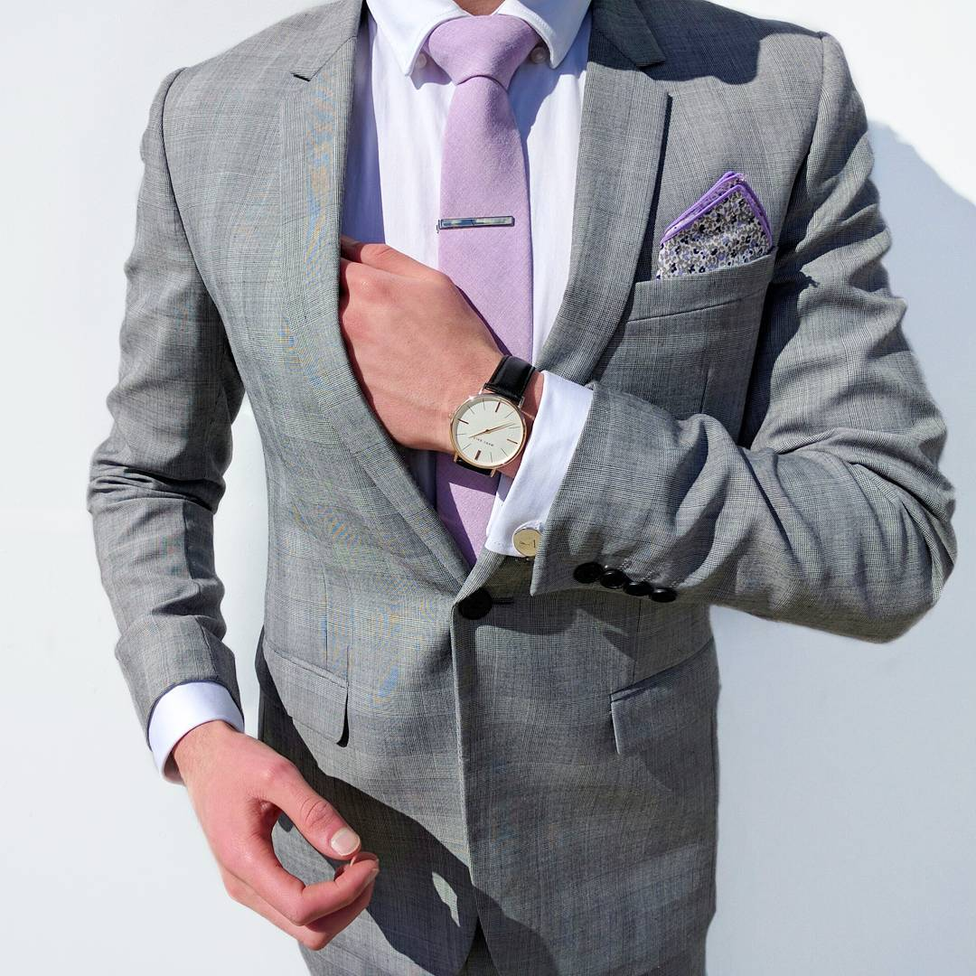 wearing white shirt tie and pocket square