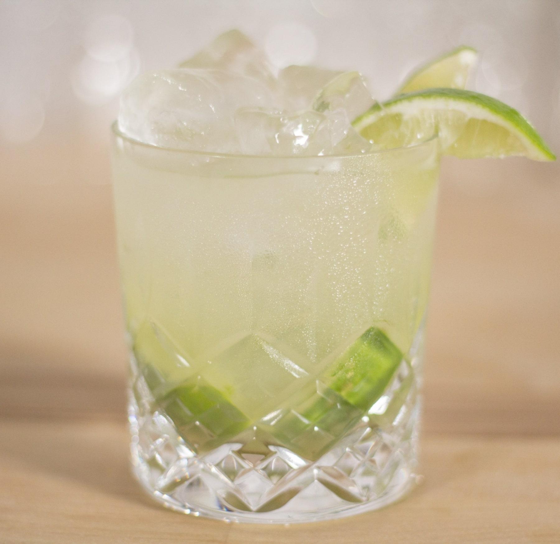 caipiroska poured in glass with lemon