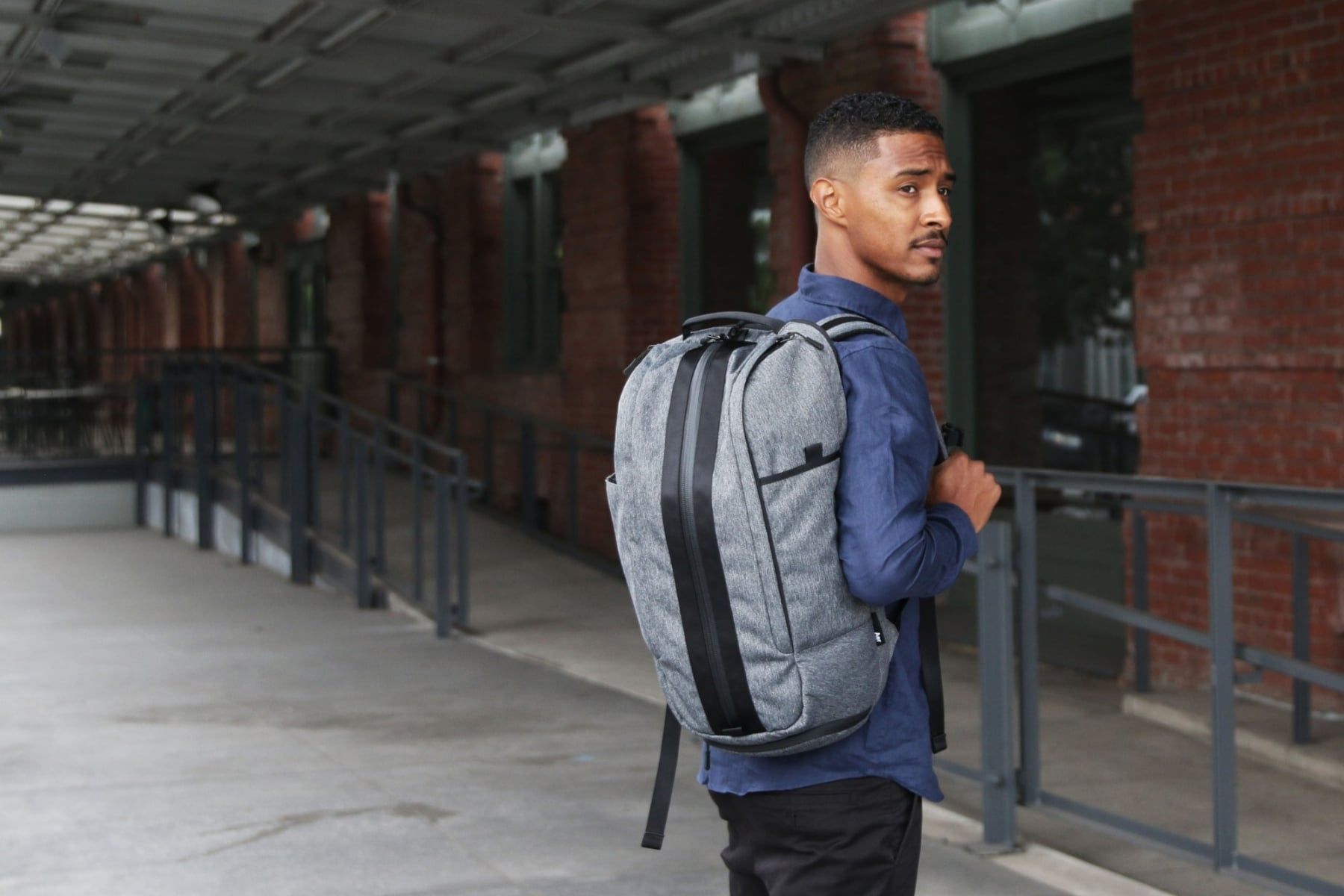 the aer brand bag carrying a man