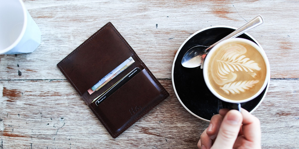 kangaroo wallet and cup of a coffee