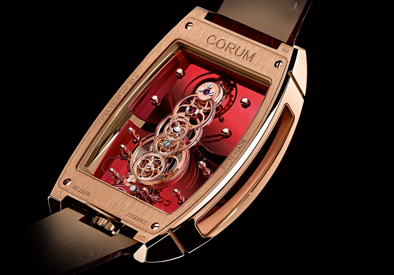 corum rose color golden bridge watch