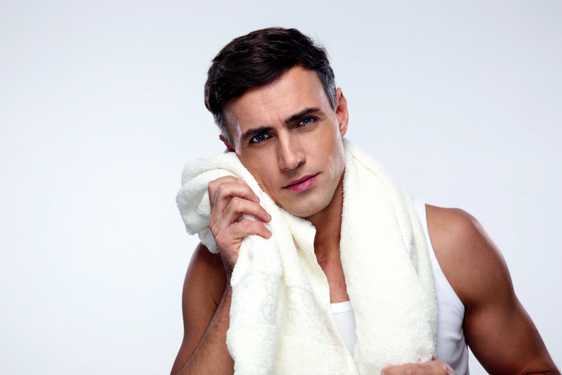 fresh men stand with towels