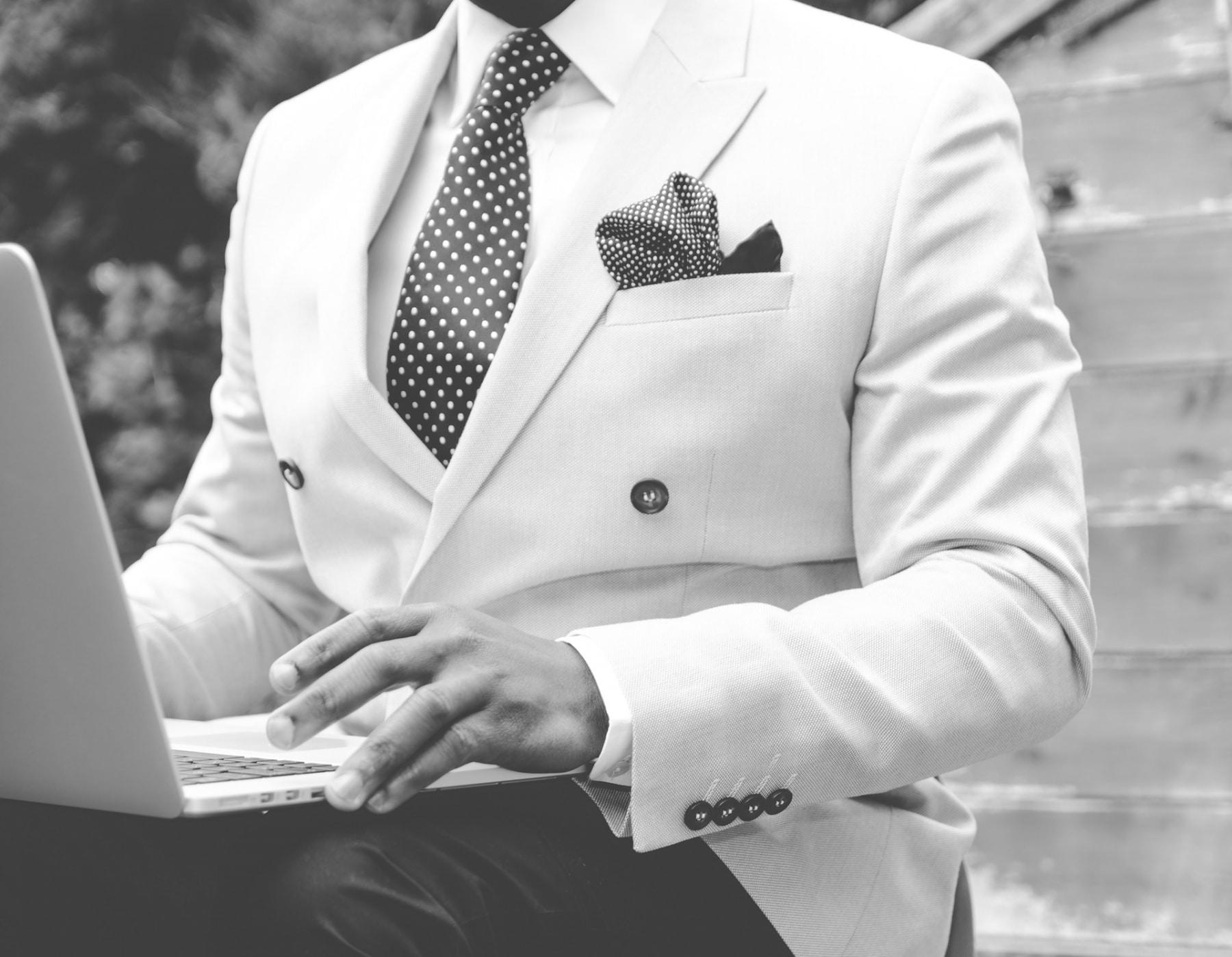 off white colour blazer using laptop
