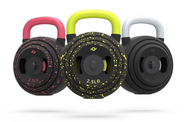 three different colors of kettlebell