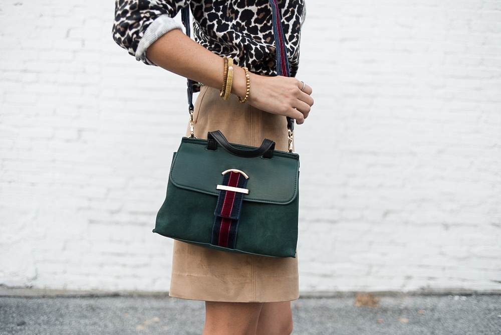 women with small shoulder bag and pencil skirt