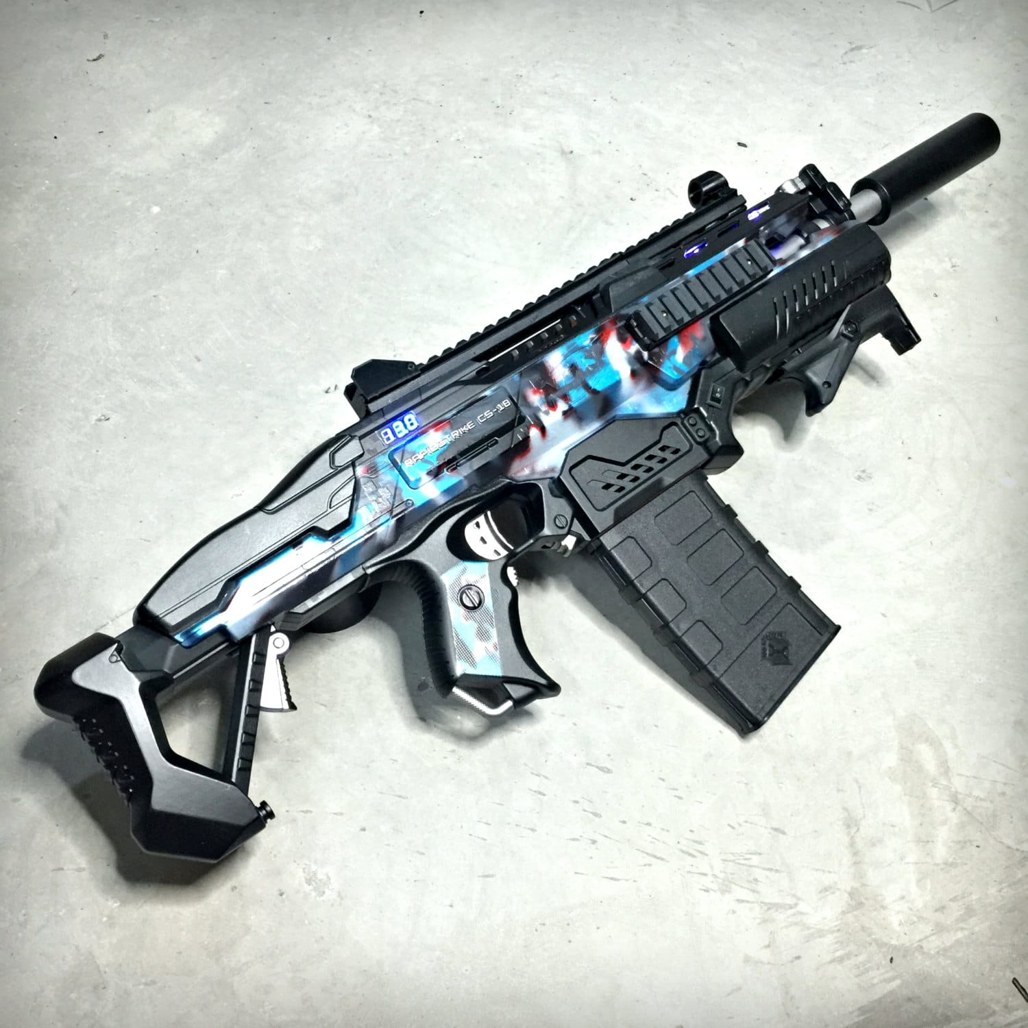 Inside the M4 Arctic Black Camo gun modifications include a full set internal rewiring internal lubrication magazine quick release lever and an upgraded