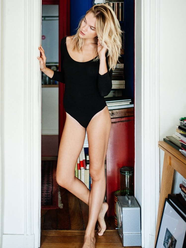 eva biechy wearing black swimsuit