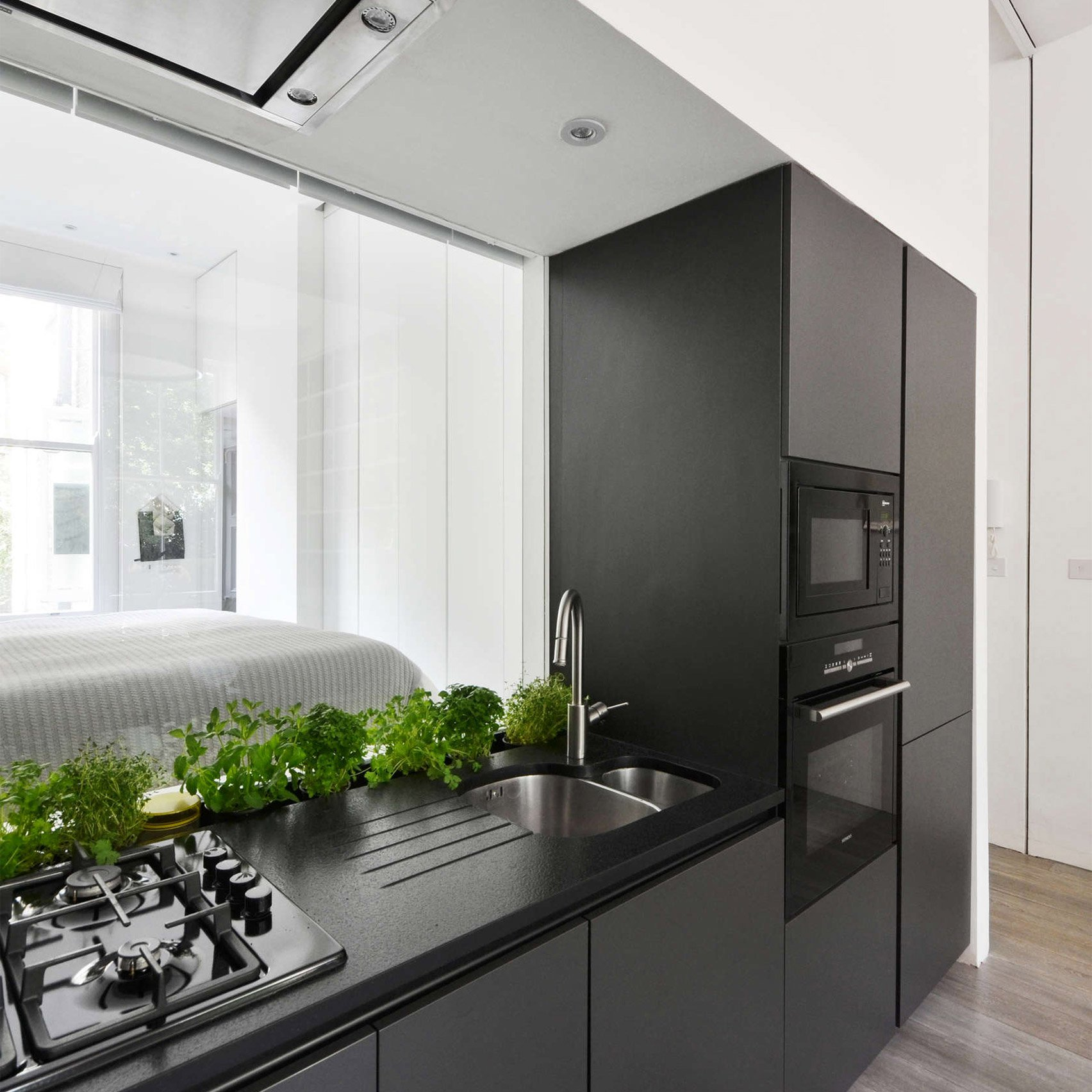 dezeen planned kitchen with high ceilings