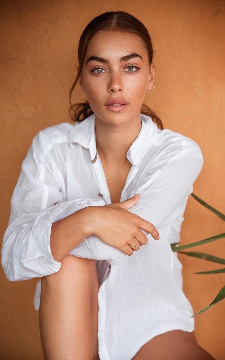 tash galgut sitting with wearing white shirt