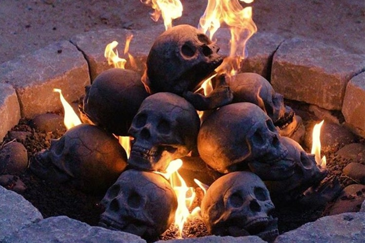 the awesomer myard human skull fire pit log