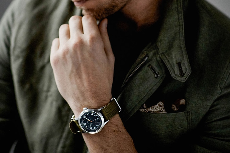 timex military watch in the hand