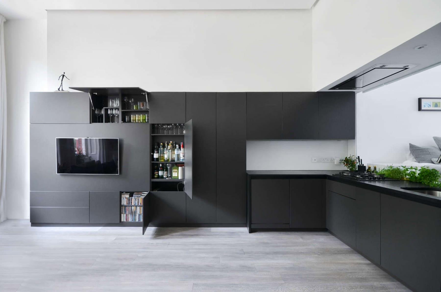 black kitchen cabinets wrap around the wall