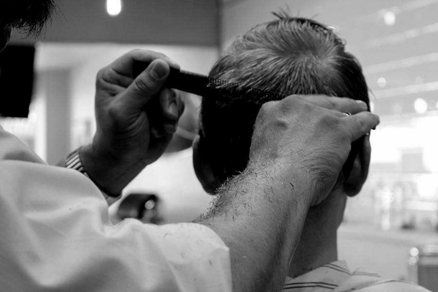 Haircut at barbarshop black and white