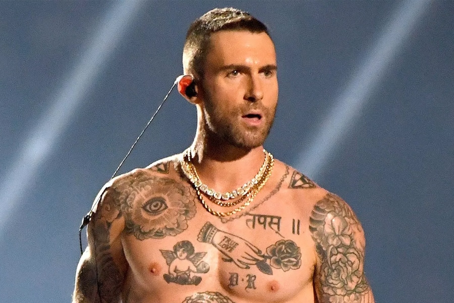 Adam Levine man with short haircut hairstyle