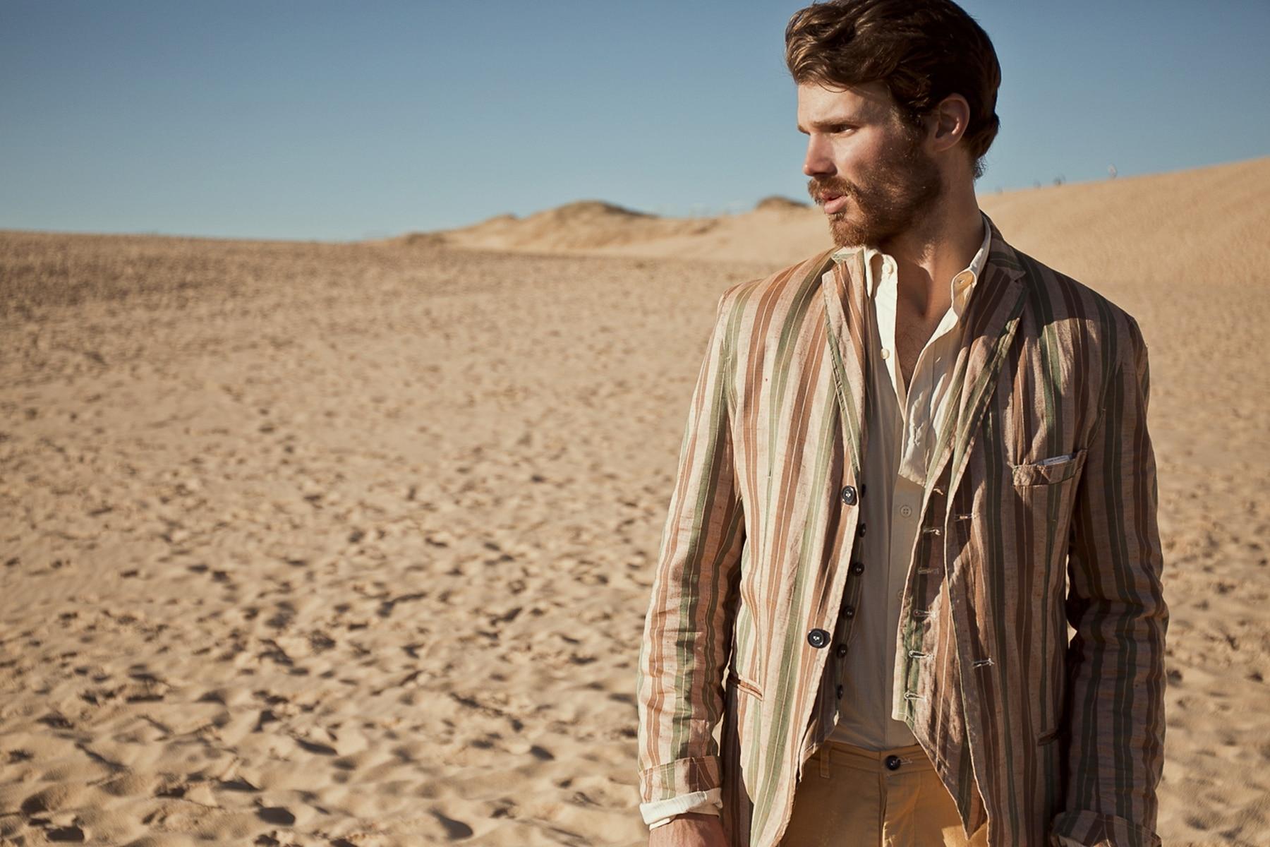 ian nessick men standing desert