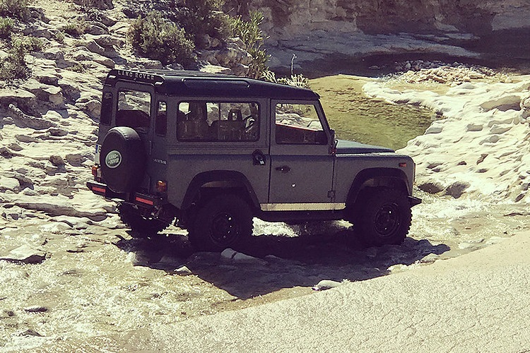 petrology land rover defender on the road