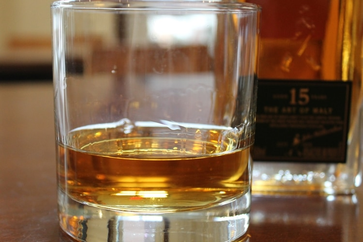 johnnie walker whisky poured in glass