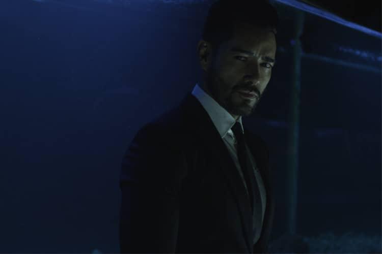 gentleman wear black x suit