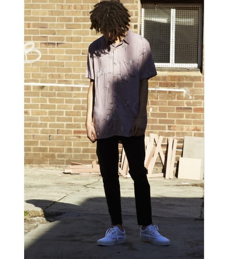 men stand wear shirt jeans