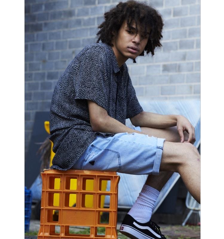 men sit plastic wear short jeans