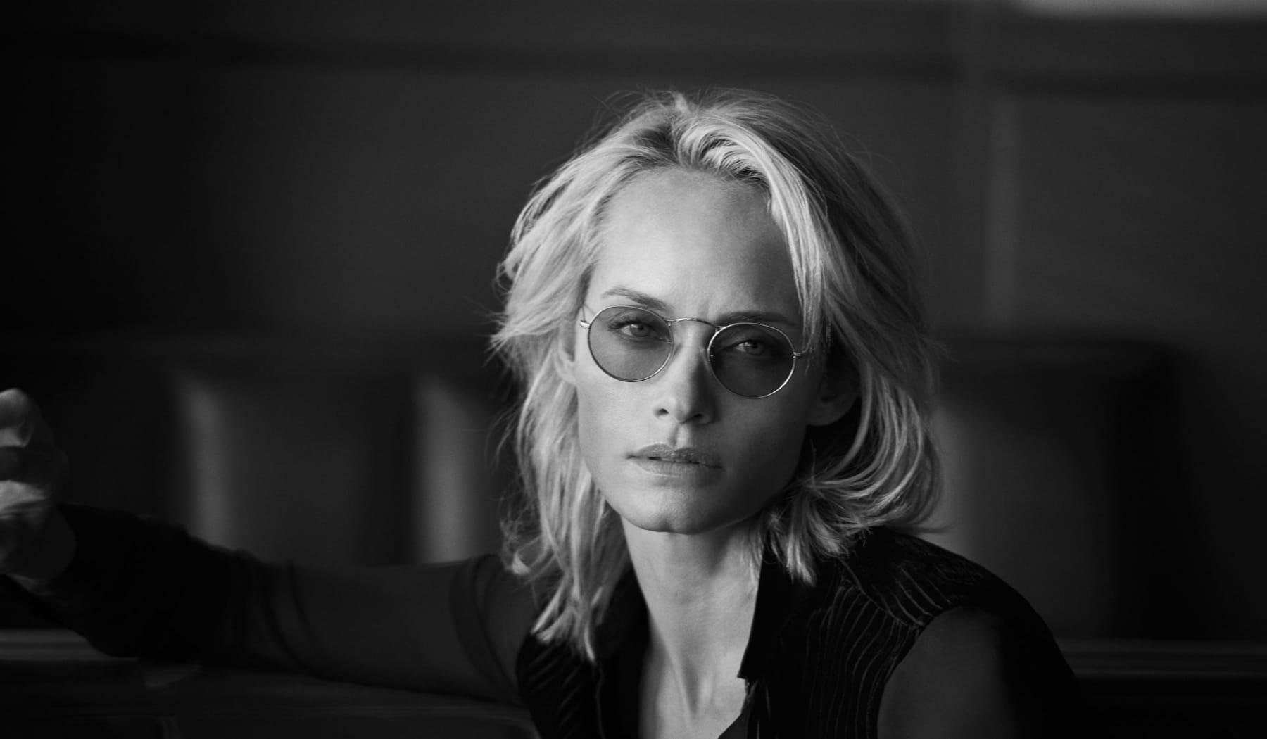women wearing oliverd sunglasses black lens