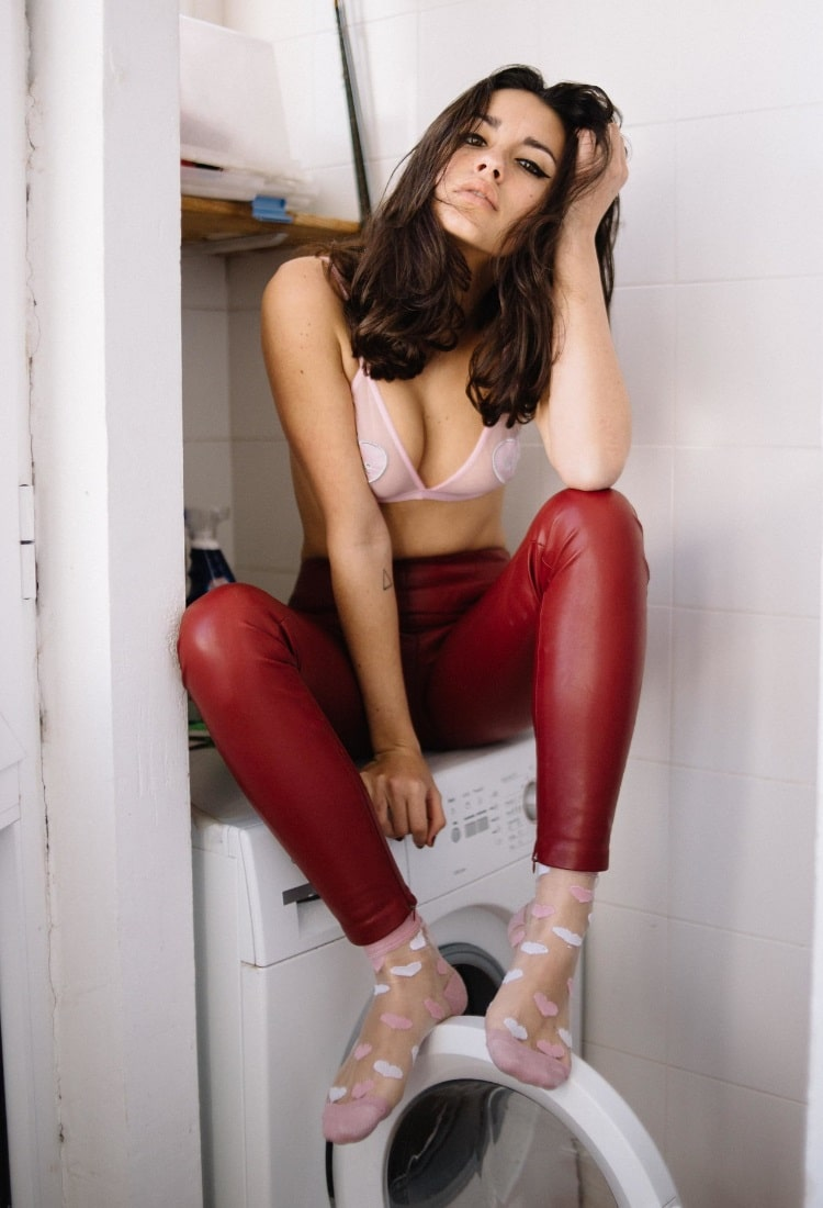 carla guetta wearing red pant with bra