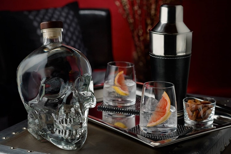 crystal head aurora vodka bottle and glass view