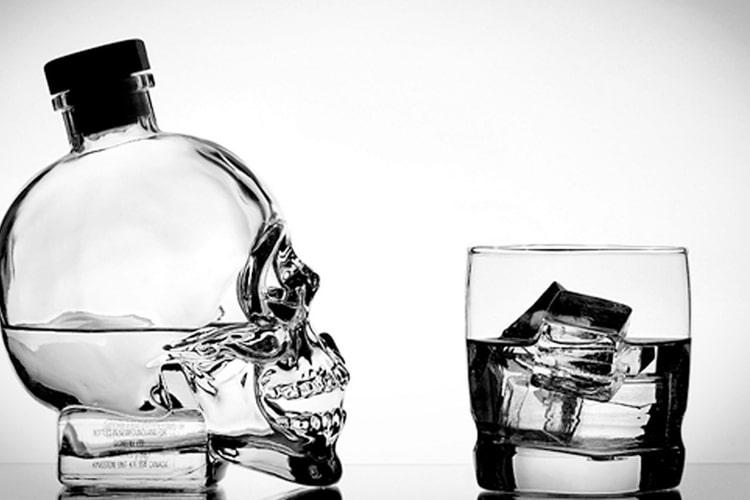 crystal head aurora vodka bottle and glass