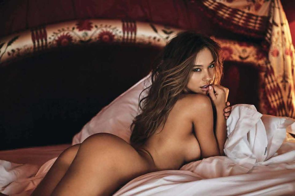 alexis ren lying down in the bed