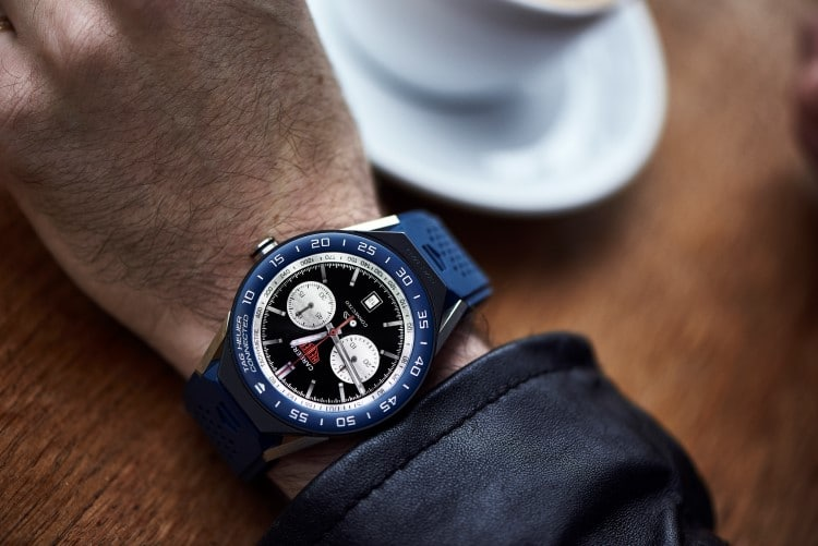 tag heuer blue color watch wearing in hand