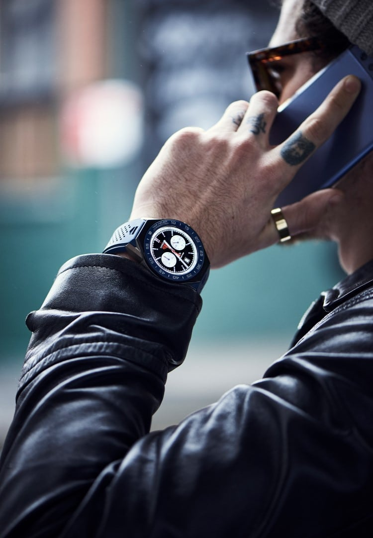 tag heuer watch wearing in the using phone