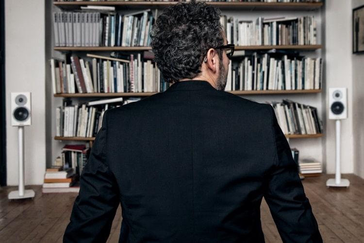 dynaudio excite x14 loudspeaker beside book shelves view