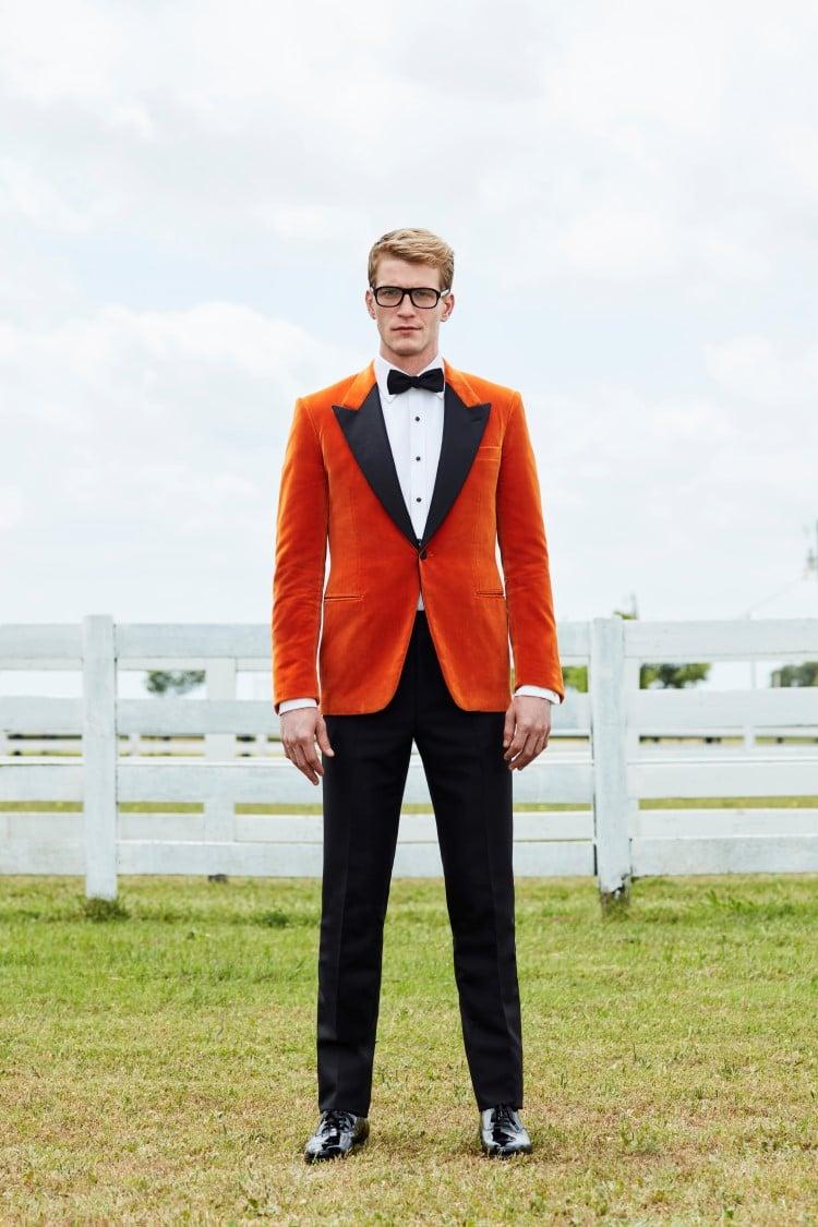 stand the men wear orange colour suit